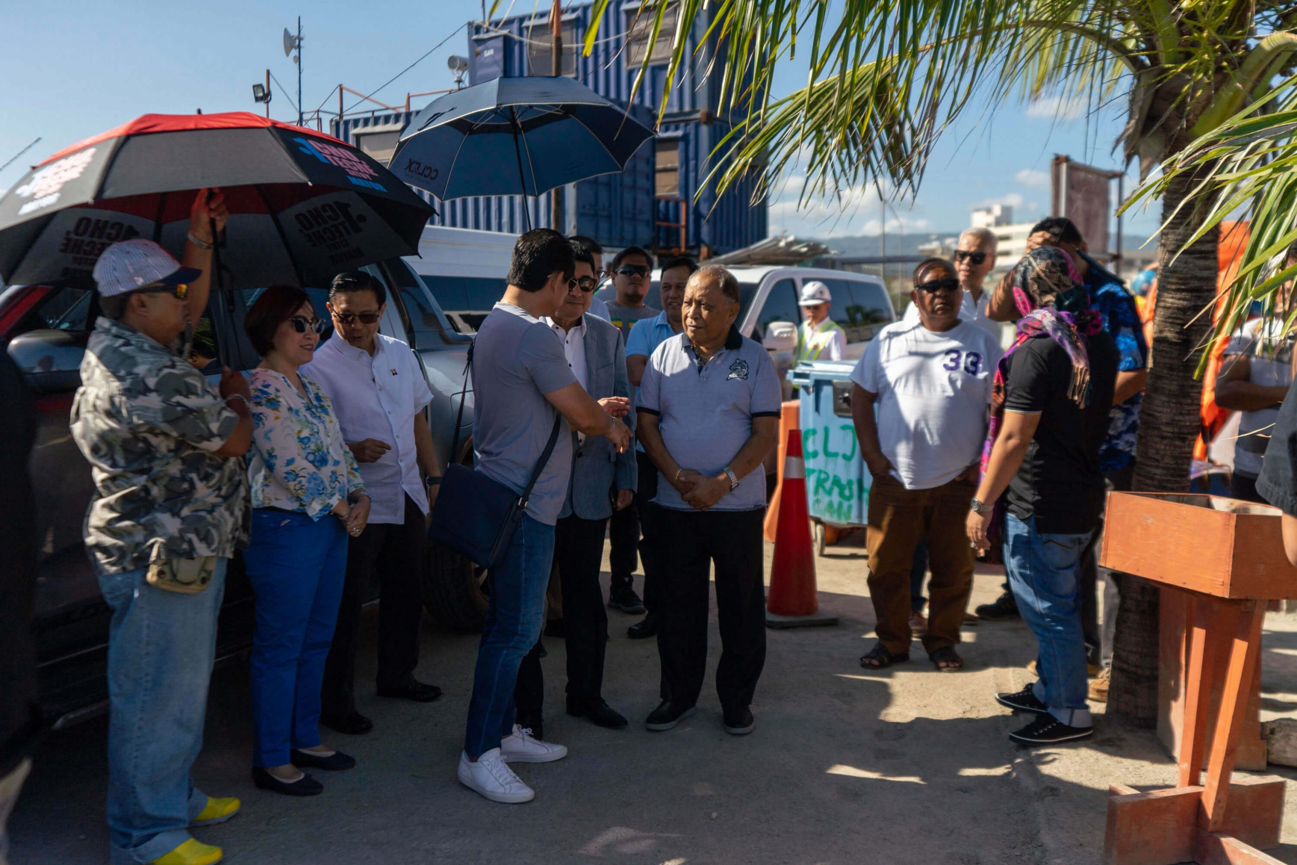 Secretary Adelino Sitoy of the Presidential Liaison Office prepares to board the boat that will take him to the construction site.